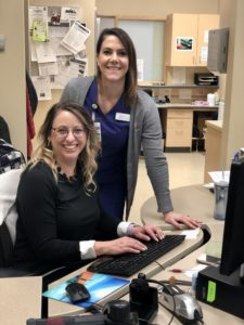 Red Deer College health-care management students Roxanne Hiebert (standing) and Andrea Luca are working on a project focusing on rural health-care recruitment and retention.