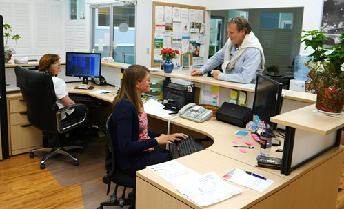 Dr. John Gillett chats with his medical office assistants at the Grande Cache Medical Centre.
