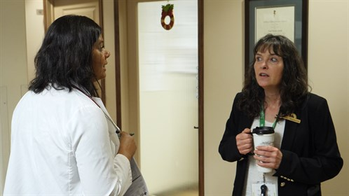 Dr. Eileen Taylor (l) discuss a patient's meds with clinical pharmacist Linda Zouboules