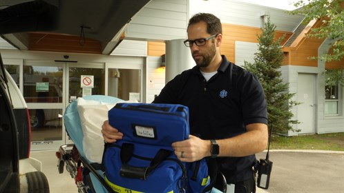 Advanced care paramedic Vincent Dazé checks his supplies on his ambulance outside the Nunnee Health Centre in Fort Chipewyan.