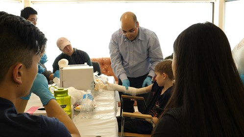 Dr. Elewadly, one of two physicians in Swan Hills, shows students how to cast.  He came to Swan Hills about a year and a half ago from Dubai.
