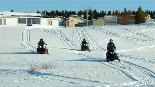 Snowmobiling is a popular pastime in Swan Hills.  Residents are allowed ride their sleds down town roads and alleys on their way to their favourite trail.