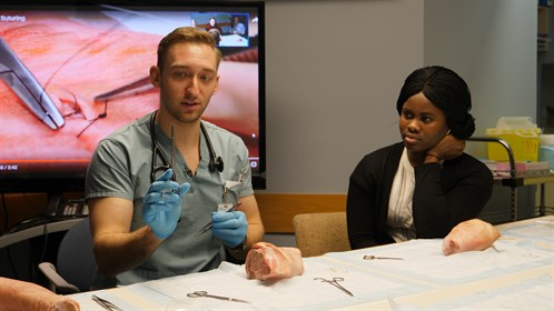 Darby Brox, a resident physician in Swan Hills, showed students the fine art of suturing.
