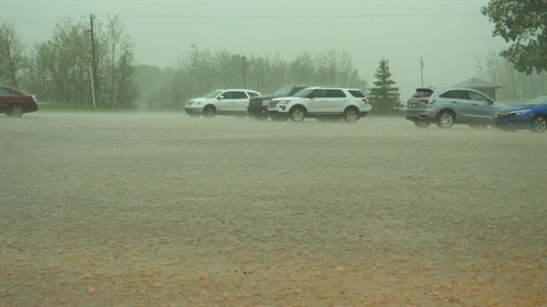 Heavy rain falls in the parking lot at the Grand Centre Golf Course in Cold Lake.
