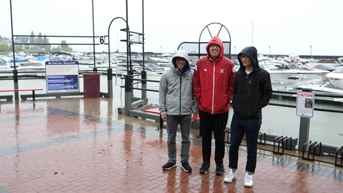 Students pose for a picture at the marina.