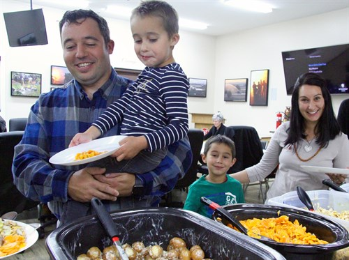 Dr. Willem De Flamingh and his wife Melody and their sons Juan and Willem help themselves to dinner at the appreciation event.